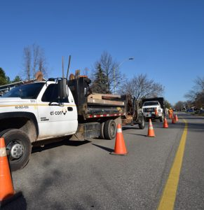 Photo of El-Con Construction Inc. trucks and work site safely identified with traffic cones