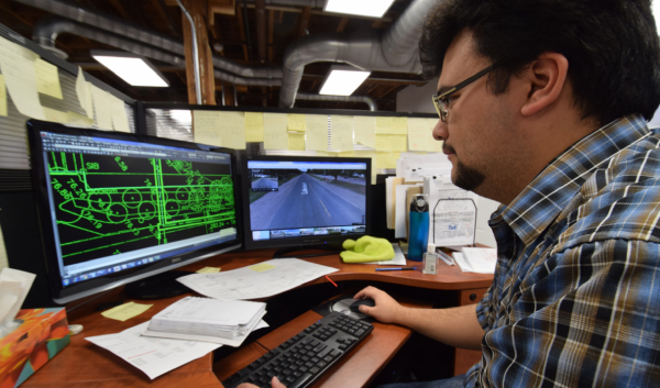 Photo of UTS Consultants Inc engineer working at computer workstation