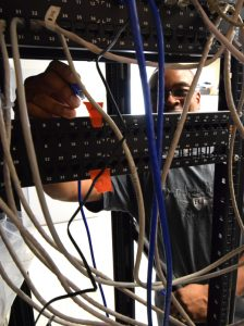 Photo of PVS Contractors employee installing a computer network.