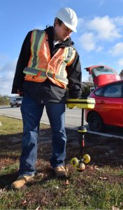 Photo of UTS Consultants engineer working in the field performing underground locate.